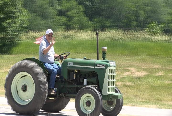 Big Green Tractor riding through the streets near Hull, Illinois.