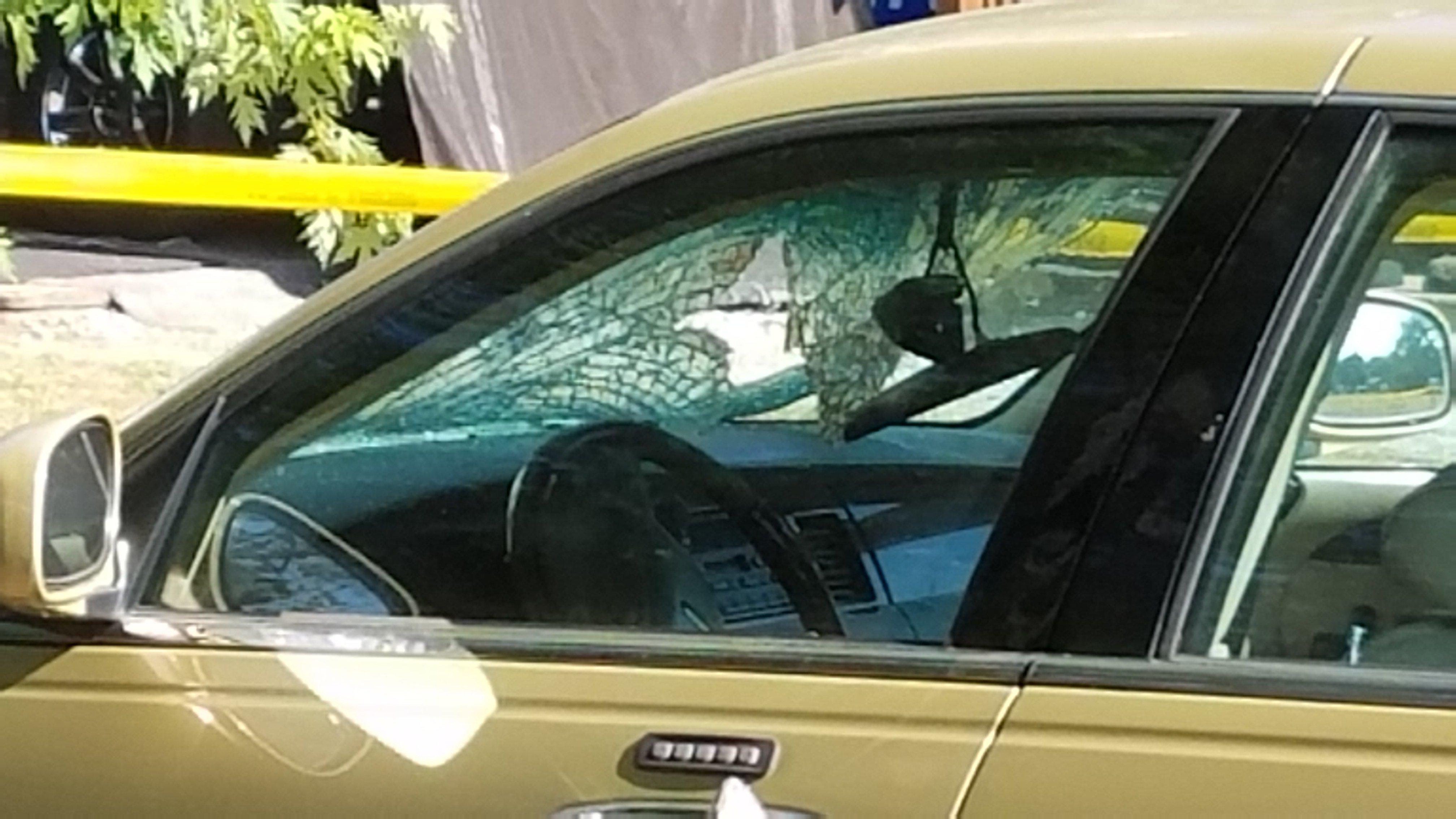 Damaged windshield at the scene.