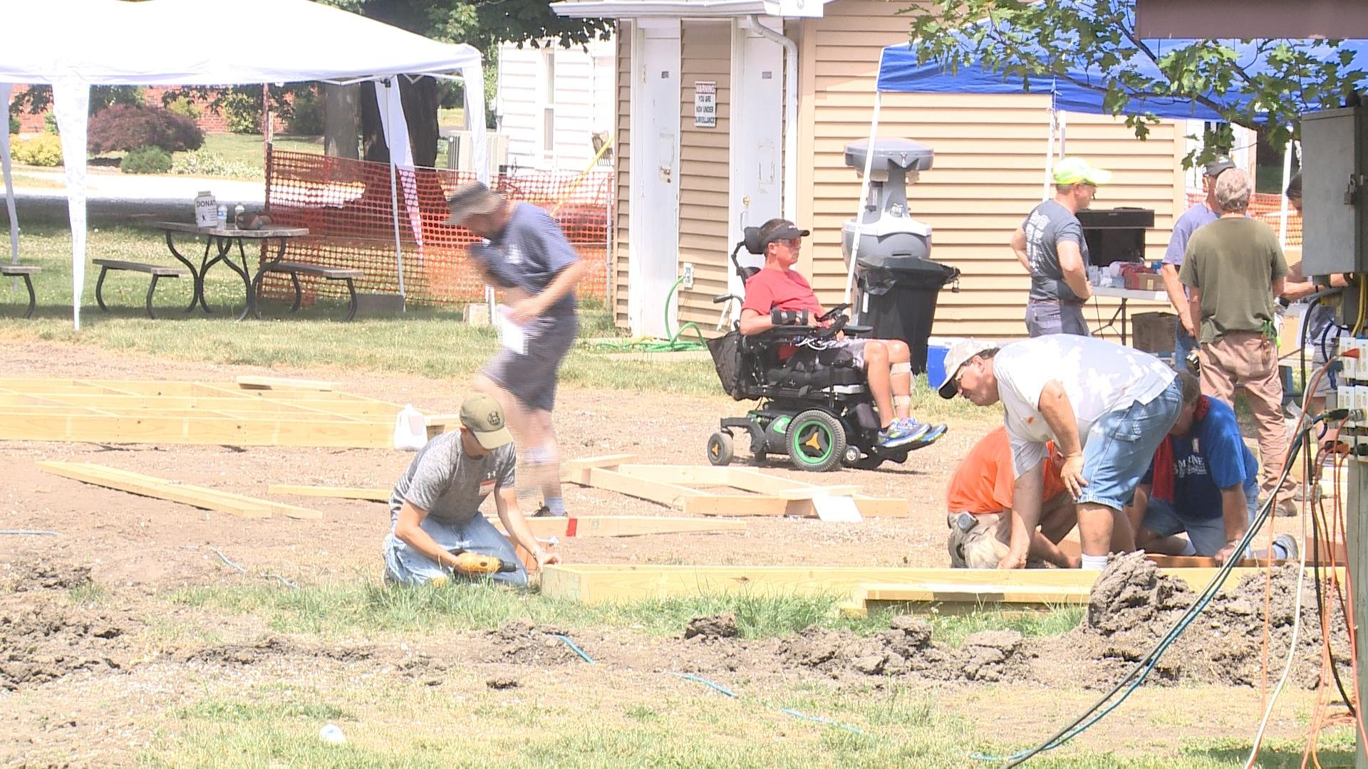 Volunteers work to build the new Wow Park in Carthage.