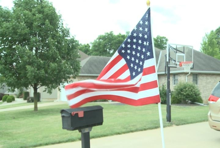 Flag in front of someone's yard