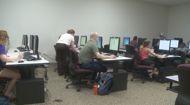 Students attend a class in the computer lab.