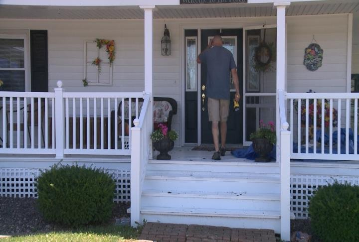 Owner walking into house