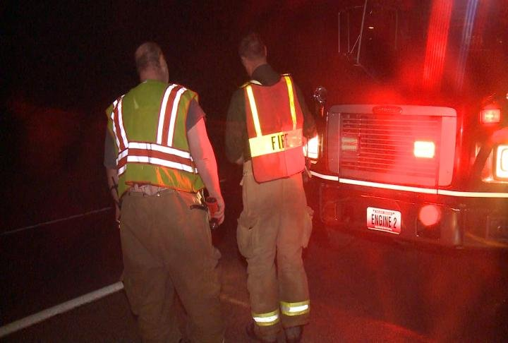 Shelbina Firefighters wear safety vests while working on Highway 36.