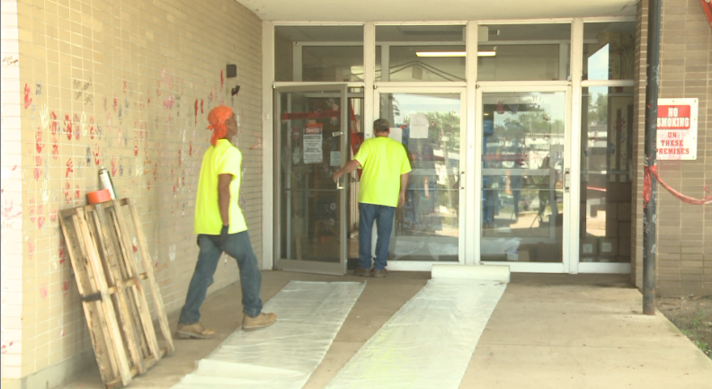 Crews removed asbestos from the school Friday.