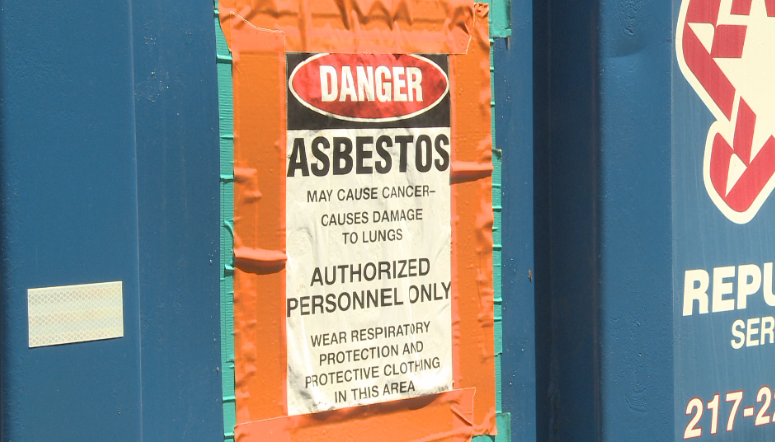 Sign warning the public about asbestos