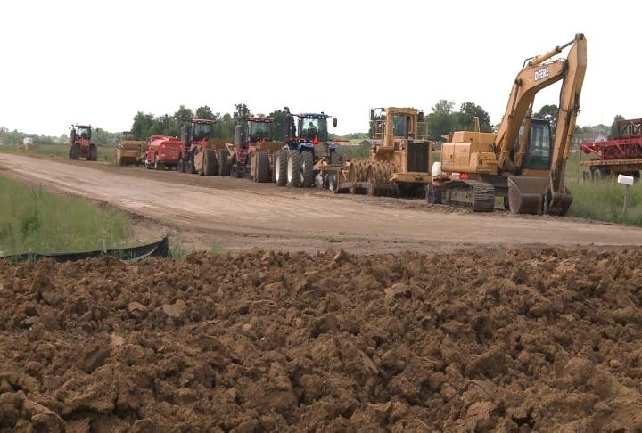 Construction equipment parked for the day at the Macomb Bypass project site.