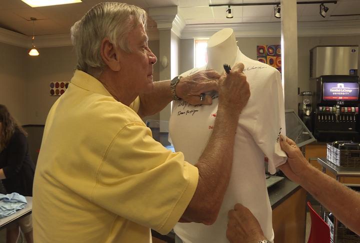 Veteran signing honor flight T-Shirt