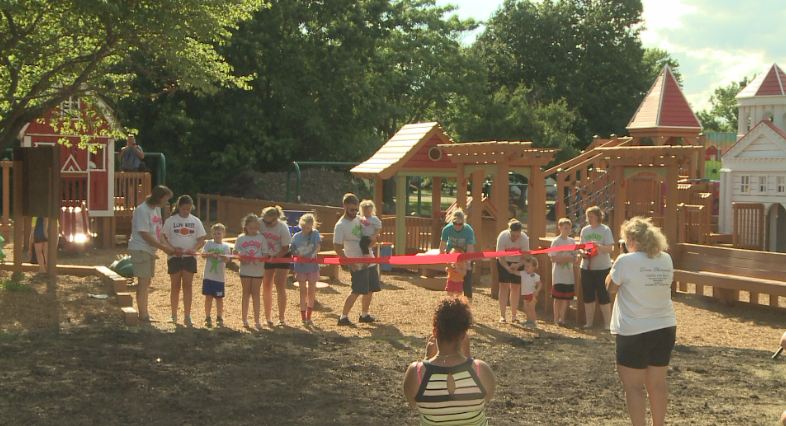 Families cut the ribbon to officially open the new park.