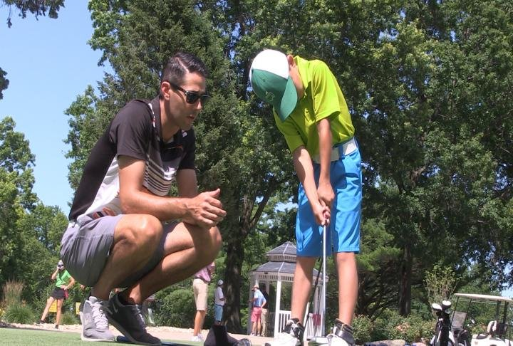 Craig and Caden Fehr from St. Louis are making their first trip to Quincy for the Pepsi Little People's Golf Championship.