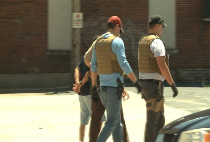 Deputies take a man into custody.