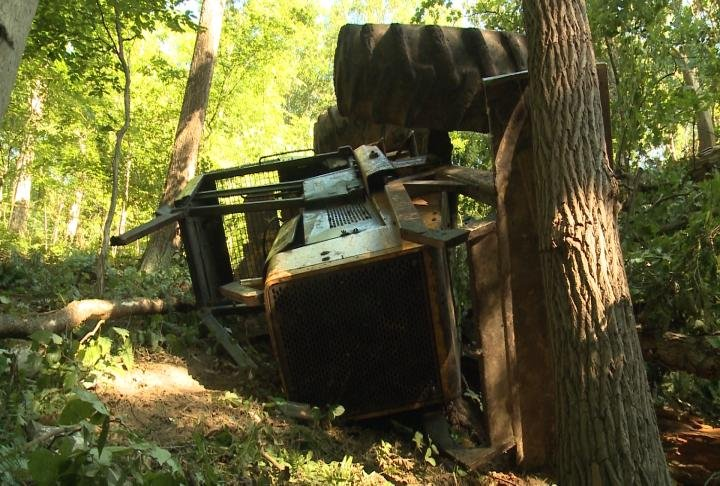 Skidder on its side.
