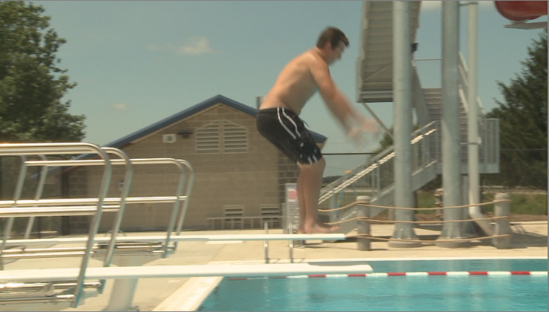 A man jumps off the diving board.