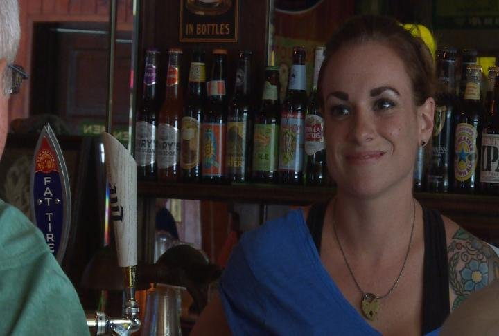 Spring Street Bar bartender Brittany Boll talks with a customer.