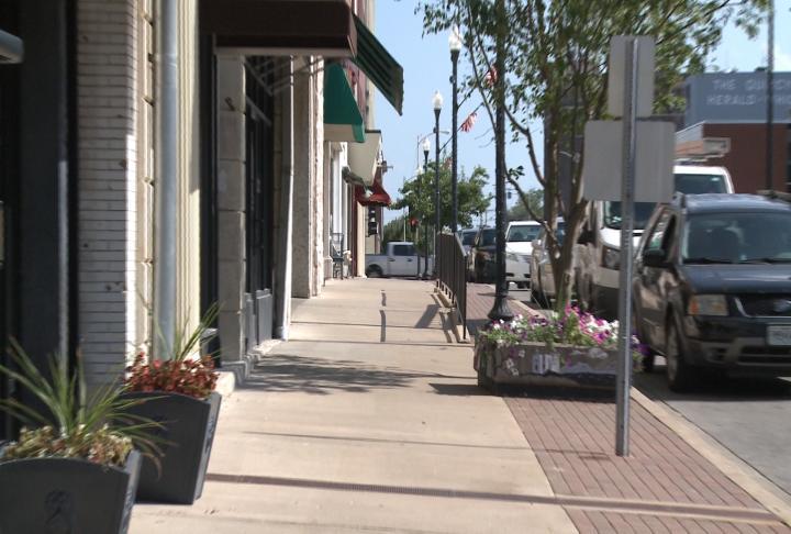 Sidewalk empty during heat stretch in Quincy.
