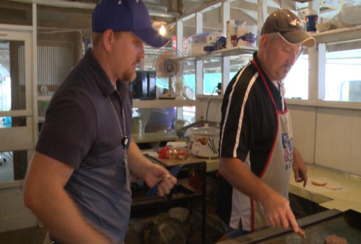 Adams County Health inspector checks over vendor's booth.