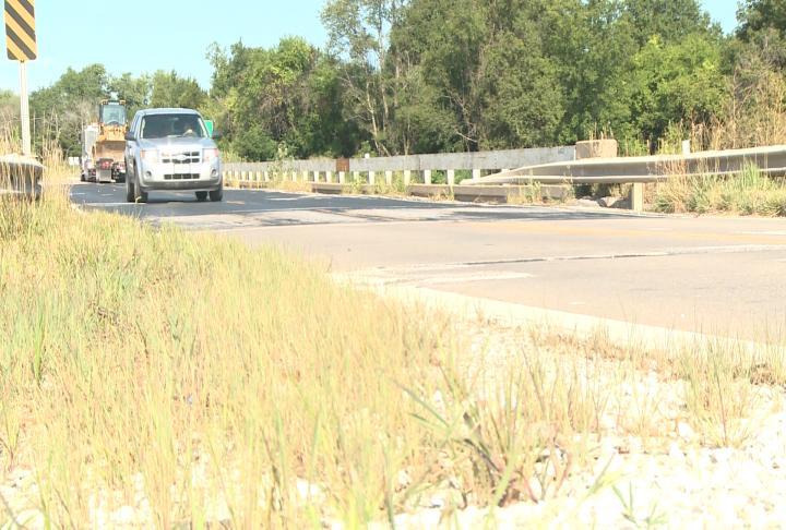 A car travels across the Missouri 168 bridge over US 61