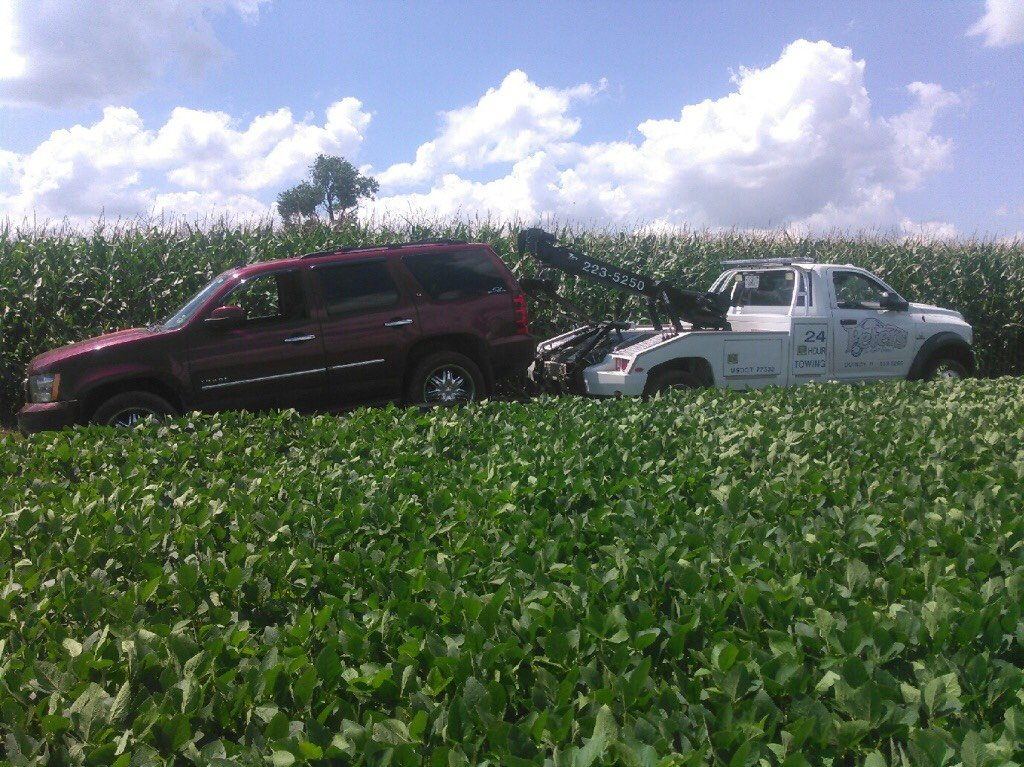 SUV being towed Saturday in an Adams County cornfield.