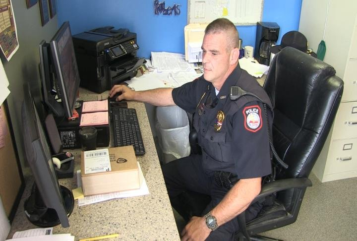 Chief Brad Roberts at his desk in the office.