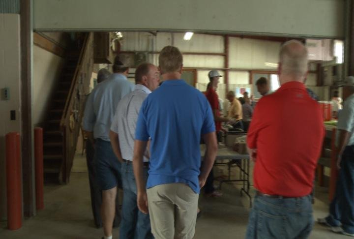 Residents wait in line for food at the celebration.