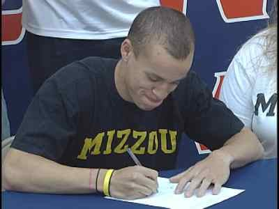 Sporting the black and gold, Illini West's Ser Whitaker signed his national letter of intent with Mizzou on Wednesday.
