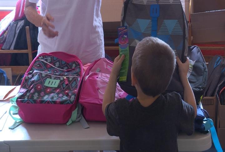 Kids taking home one of 1,000 backpacks for families.