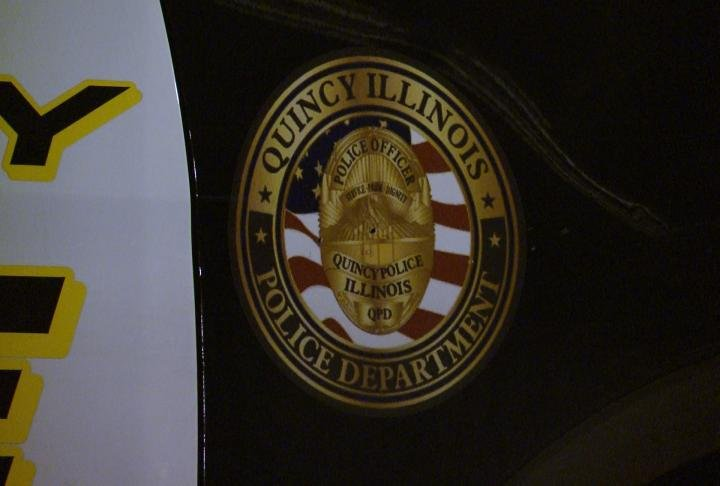 Quincy Police Department badge logo displayed on side of SUV.