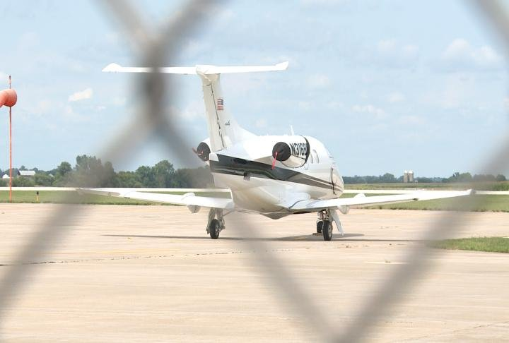 Jet parked on runway at Quincy Regional Airport