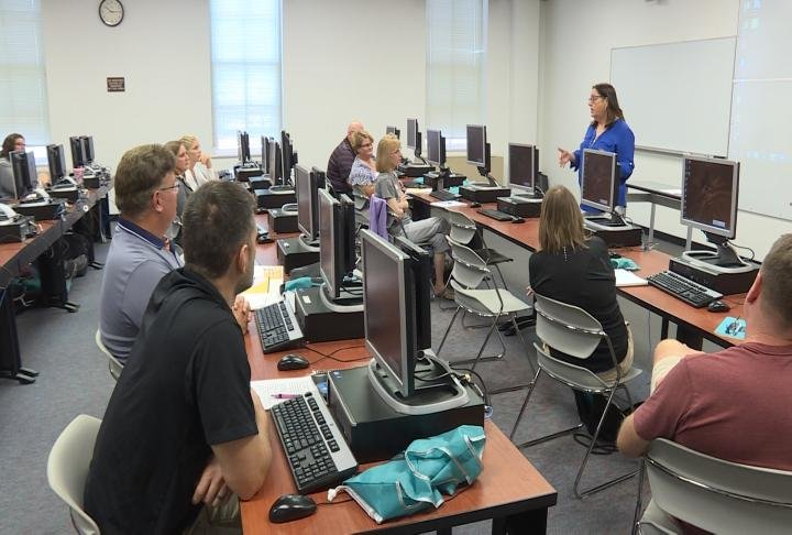 Teachers in the computer lab at Quincy University
