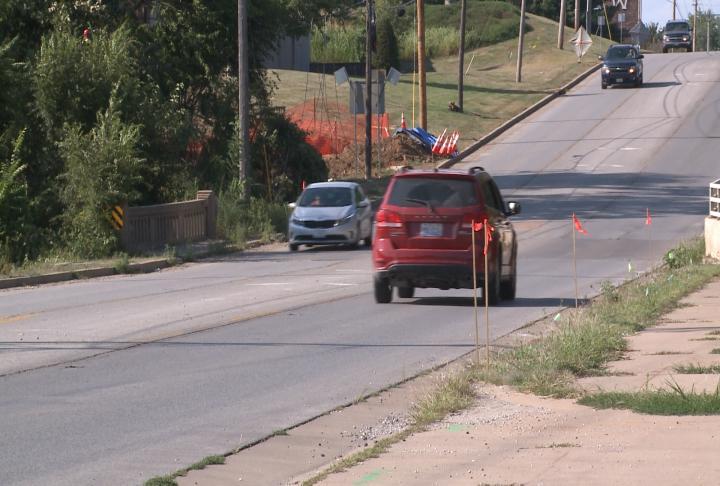 Cars drive over Cedar Creek Bridge in Quincy.
