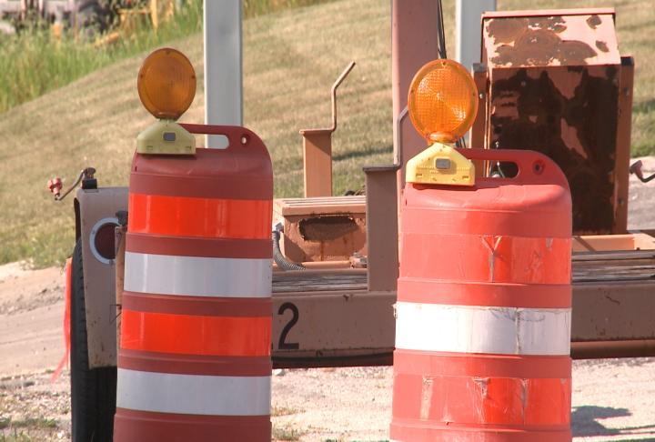 Traffic cones put up ahead of construction on Cedar Creek Bridge.