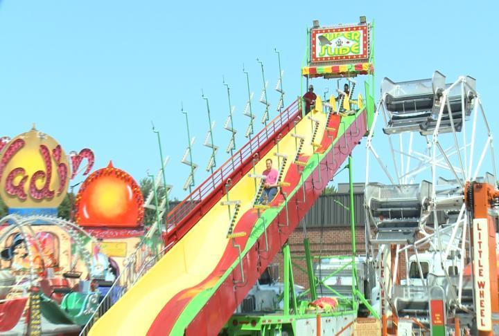Man rides down a slide Thursday morning.