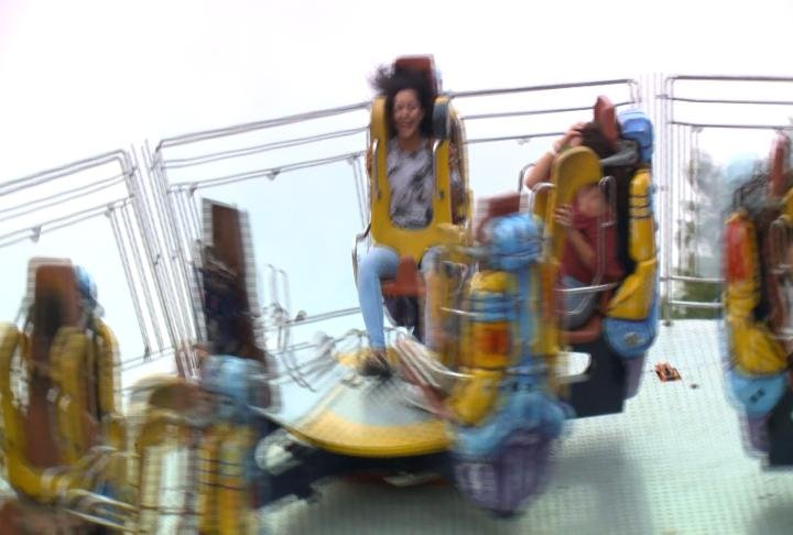 Resident screams on amusement ride.