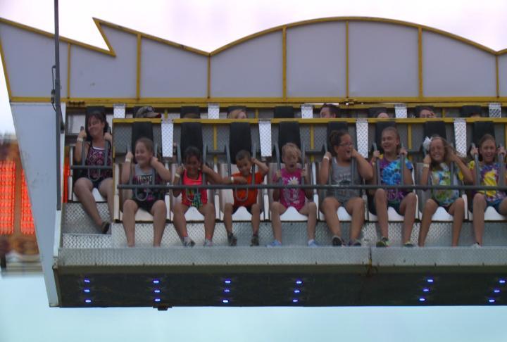 Residents enjoying amusement ride.