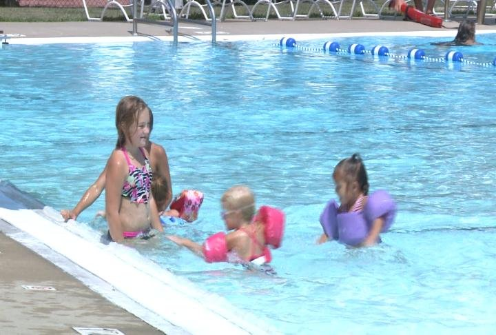 Visitors swim at Indian Mounds Pool in Quincy