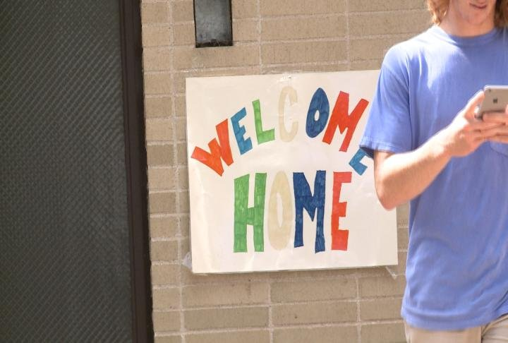 Welcome home sign on campus