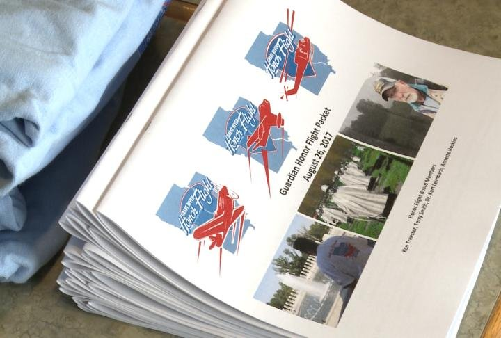 Honor Flight packets for the trip.