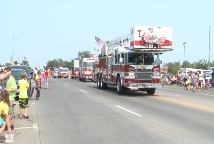 Fire trucks coming down Main Street.