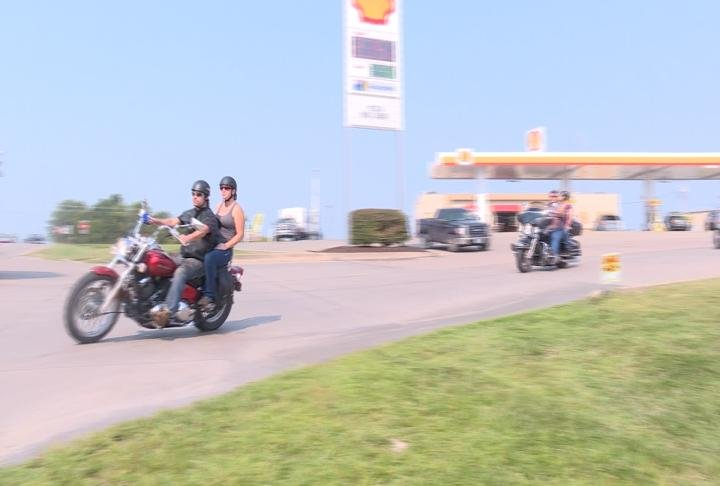 Bikers leaving the gas station in New London
