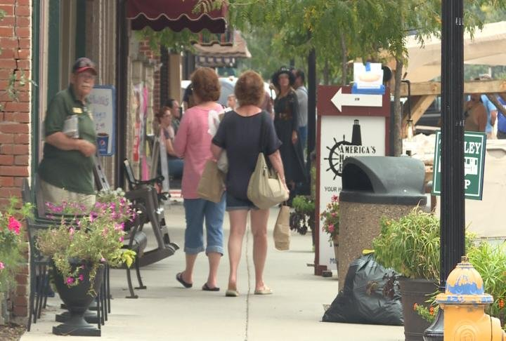 Shoppers walk down Hannibal's downtown district.