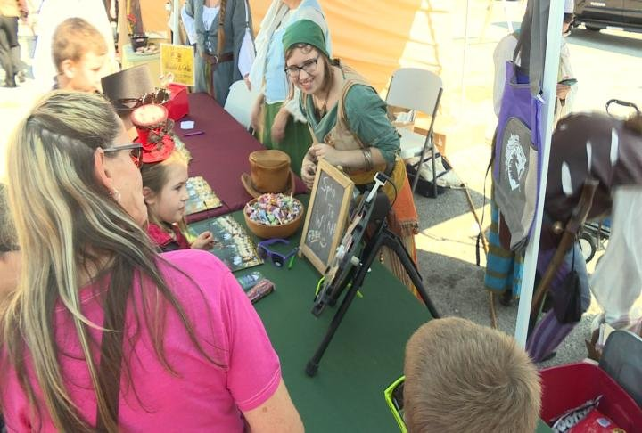 Shoppers look at gifts during Hannibal's Steampunk Festival.