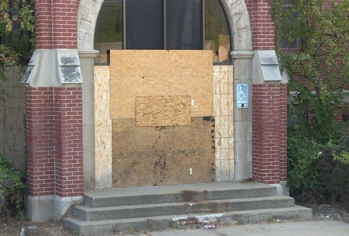 Doors to the former St. Elizabeth Hospital in Hannibal remain boarded up.
