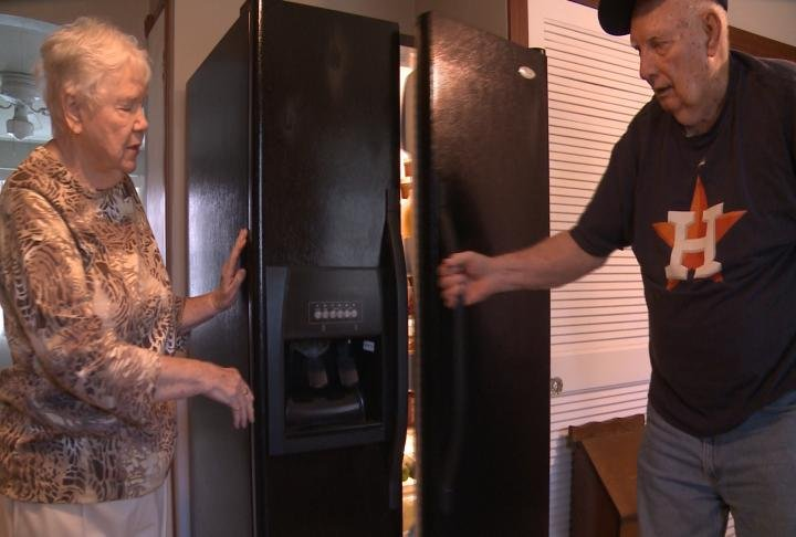 Bob opening the fridge in their temporary Quincy home