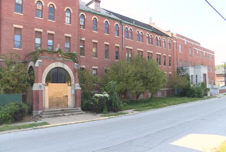Boards block the front door of the former St. Elizabeth Hospital in Hannibal.