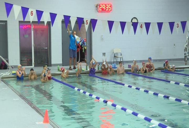Hannibal Swim Team practice in the YMCA pool after it recently opened back up.