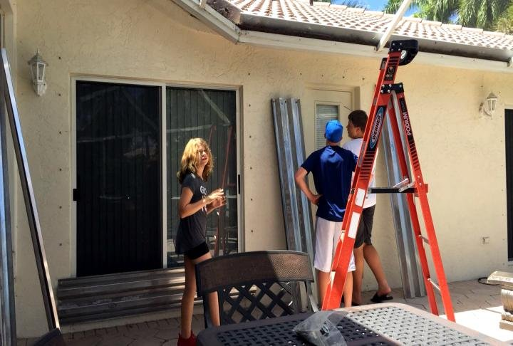 Mosley's children and neighbors helped add hurricane shutters to his home.