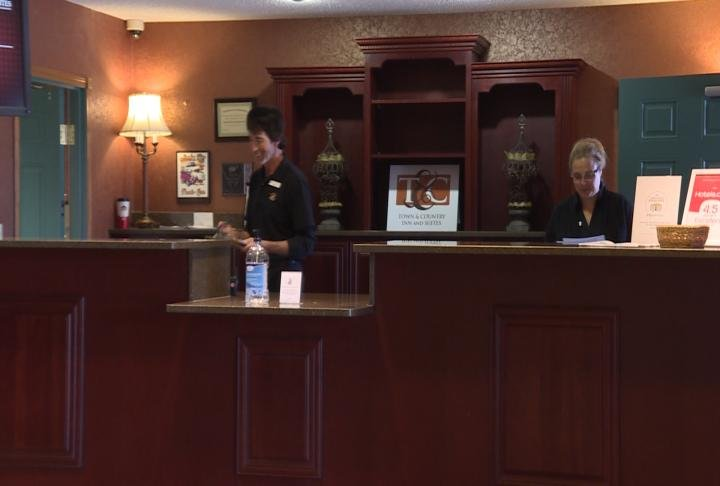 Workers at Town and County Inn and Suites in Quincy, finish up tasks.
