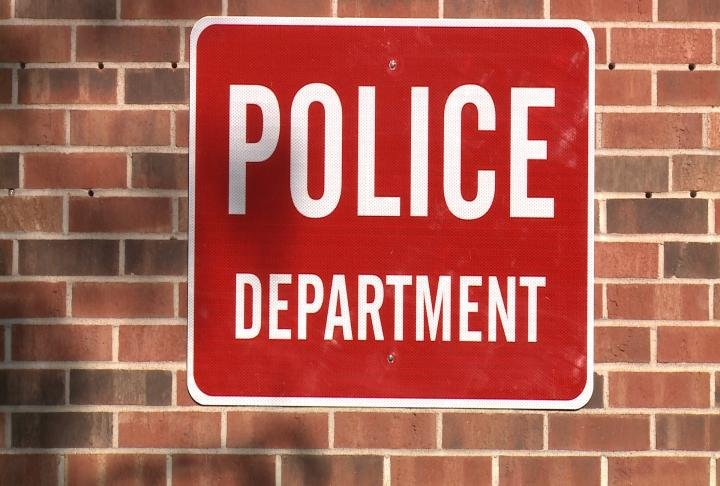 Police Department sign hung on side of building.