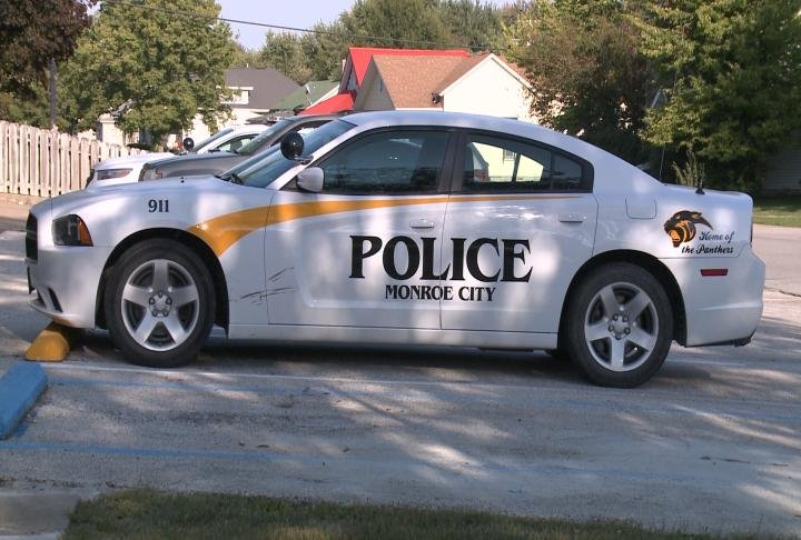 Monroe City Police Department car parked in lot.