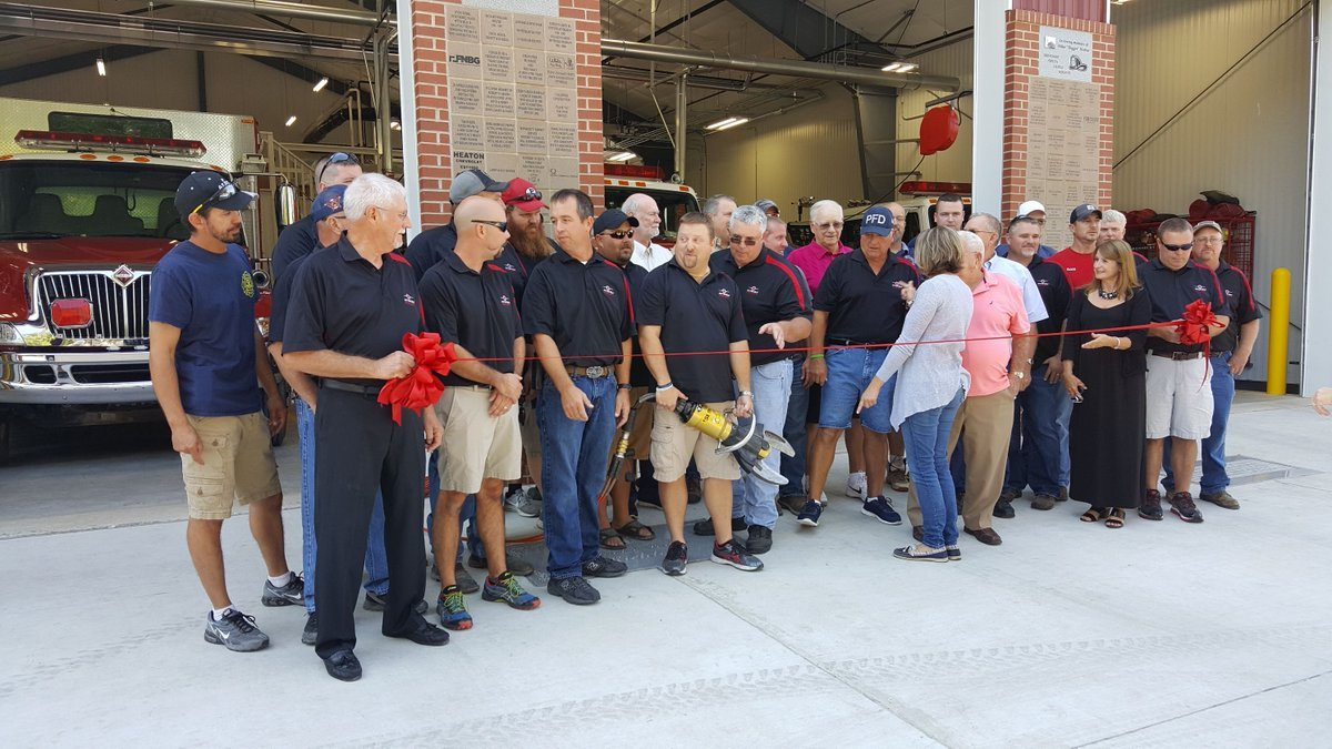 The Pittsfield Fire Department and city leader cutting the ribbon to the new station