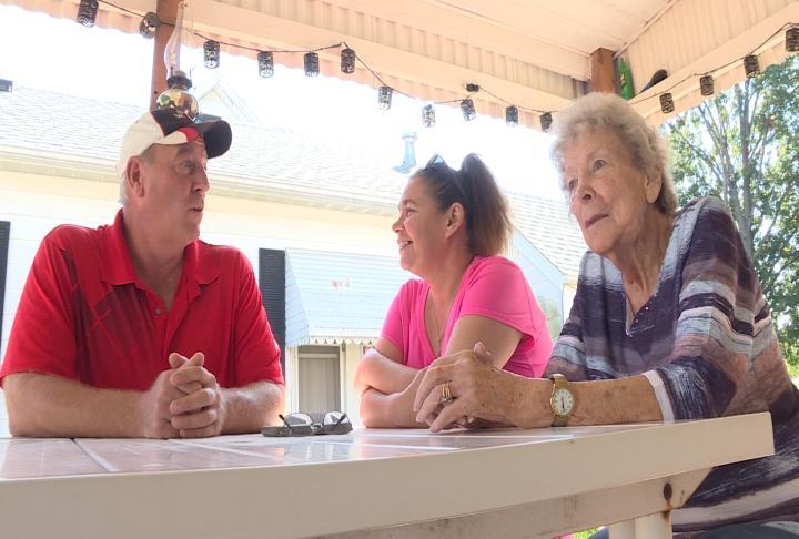 Joe, his fiance Bernie and their neighbor Jackie sitting around a table